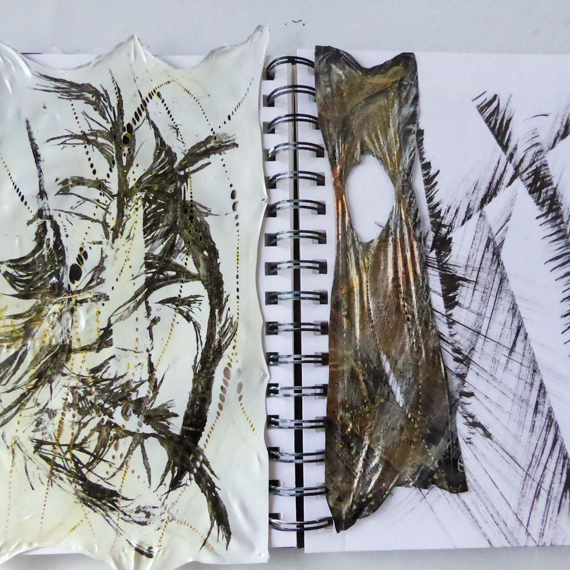 Feather marks in sketchbook